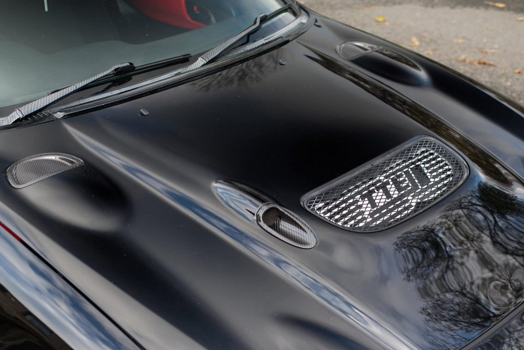 Carbon fiber inserts in hood