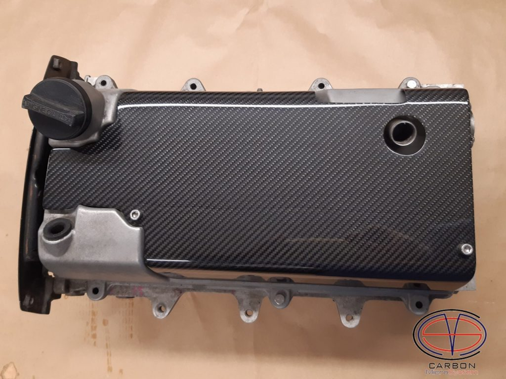 Spark plug cover from Carbon Fiber engine