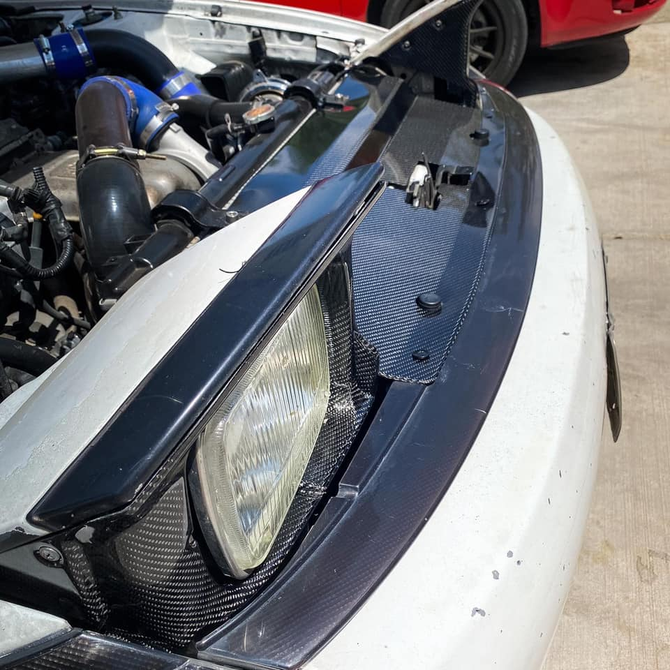 Carbon fiber headlights surround and cooling panel