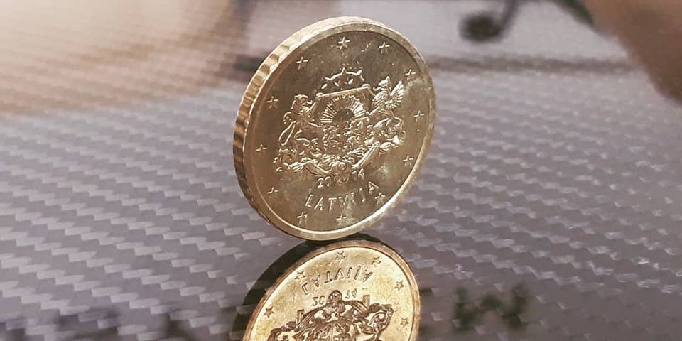 Euro coin on carbon roof